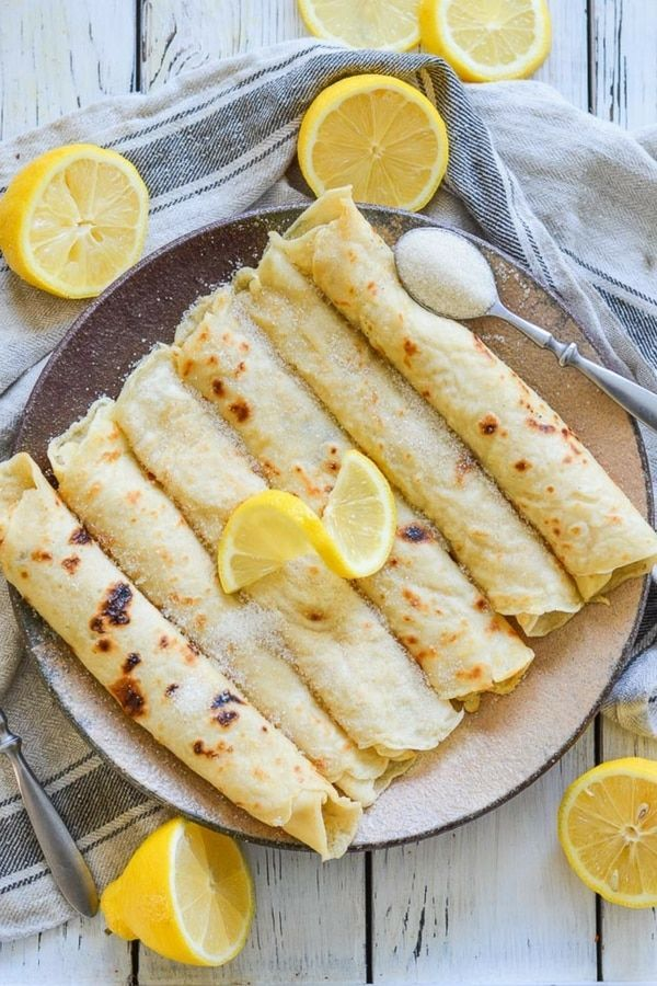 FoolproofVegan English Pancakes. Quick & easy to make & great for dessert or brunch! They are beautifully freckled and so good straight from the pan, served glistening with fresh lemon juice & sugar.#pancakes #veganpancakes #englishpancakes #pancakeday #shrovetuesday #fattuesday  via @avirtualvegan