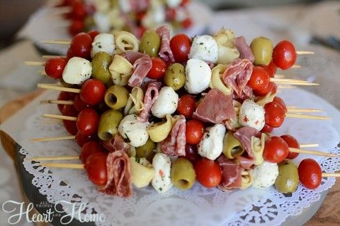 italian appetizers ital sausage, salami, baby bell, tom, olives, artichoke hearts, marinate in ital dress