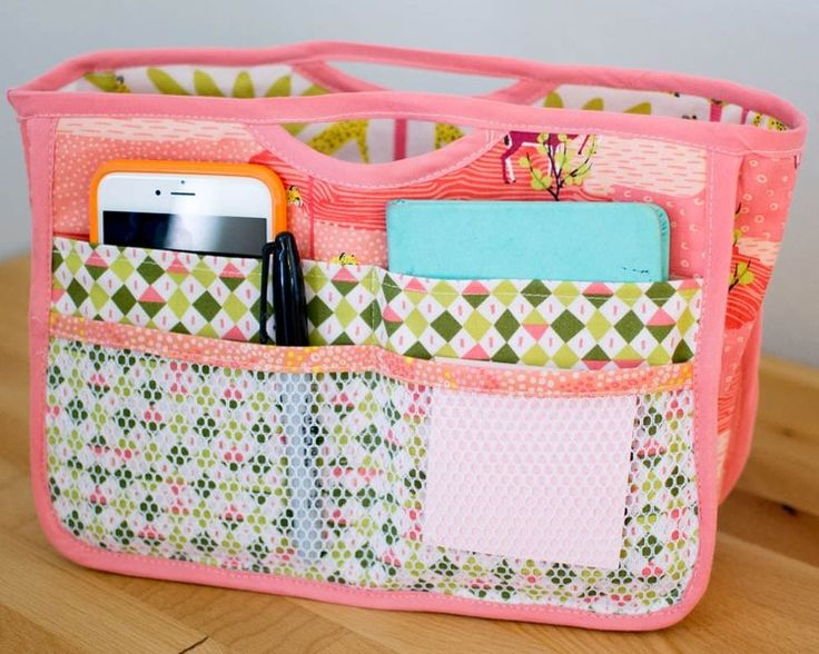 Handy purse organizer. Wouldn't this be fun to have in plarn bags!