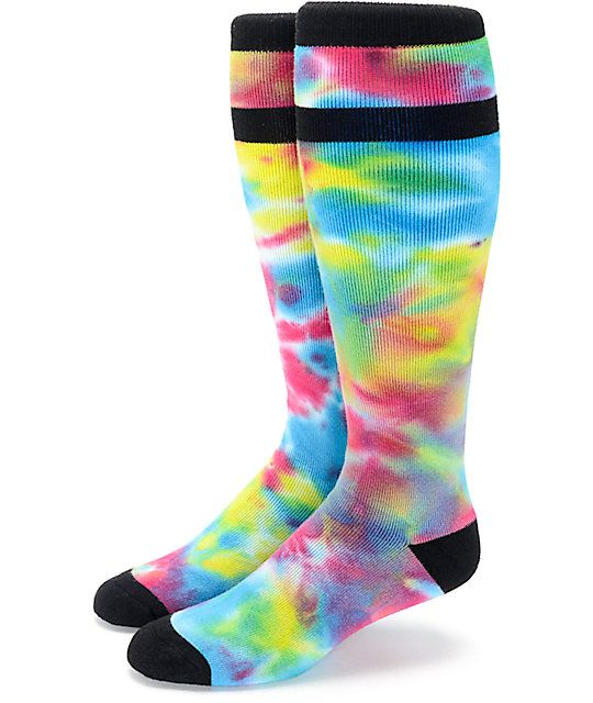 Give your feet the comfort they need when up on the lifts with the Aperture Blastoff Tie Dye Snowboard Socks. These socks are designed as knee length snowboard socks with self adjusting ribbed cuff for a secure fit and a cushioned footbed for comfort. Thick and all around soft, these are a great accessory when hitting the slopes, keeping you warm and snug when facing the colder elements.