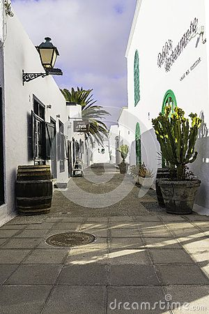 Traditional building in white colour and green windows . Typical street and  architecture of Costa Teguise  on Lanzarote . Canary Islands. Spain.