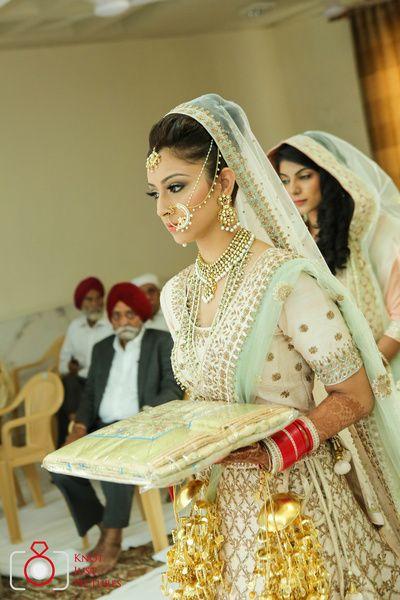Bridal Portrait - Mint Green and Ivory Colored Lehenga | WedMeGood | Ivory Lehenga with Gold Embroidery, Gold Kaleere and Mint Green Net Dupatta #wedmegood #bridalportrait #ivory #mintgreen #indianbride #indianwedding #kaleere #satlada