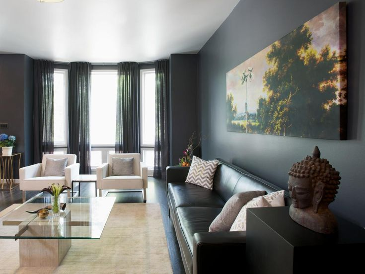 Not quite sold on black in your home? See how dark shades of color add drama to these seven rooms.