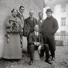 Members of the Blue Rider group on the balcony of Kandinsky's apartment at Ainmillerstraße 36, Munich, 1911/12 Left to right: Maria Marc, Franz Marc, Bernhard Koehler Sr., Wassily Kandinsky (seated), Heinrich Campendonk, Thomas von Hartmann.