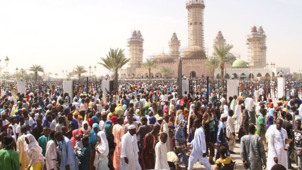 Pilgrims outside the grand mosque