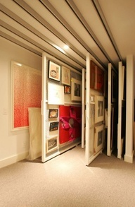 Very space efficient sliding panel display storage with folded door covers for those pieces you've seleted to show similar to how art museums store their collections of art |