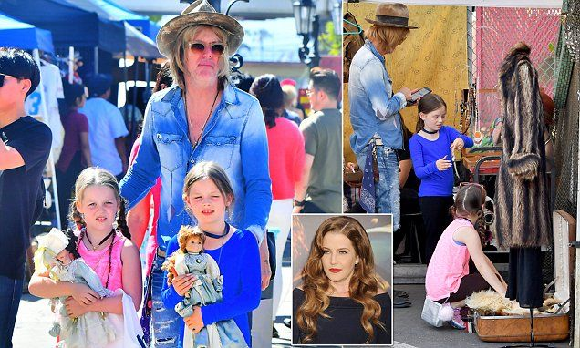 Lisa Marie Presley's estranged husband takes their twins for an outing