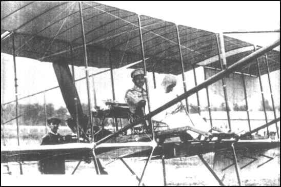 First Thai flight 1911. First flying demonstration in Siam. Prince Chakrabongse {Chief of Army General Staff} behind Belgian