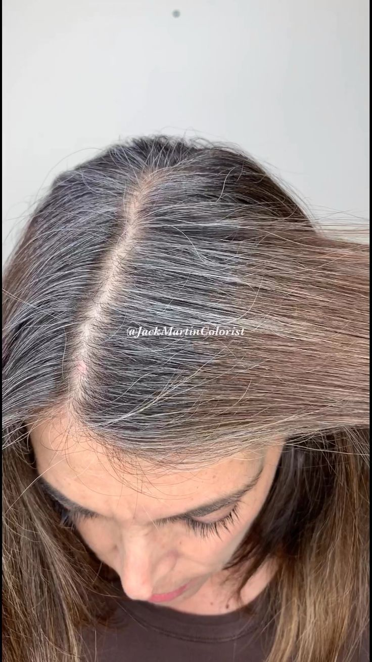 Brassy to silver hair to match her roots. Check link below for detailed formula.