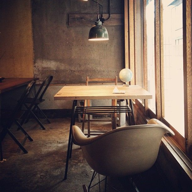 This cafe interior looks very modern but at the same time it looks a bit old with its colour scheme. The differnt chairs along with the lighting help create a intimate feeling.