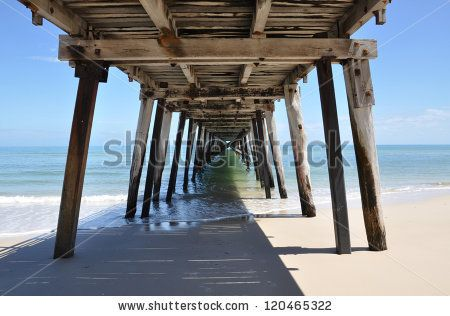 Underneath the Grange Jetty in sunny South Australia taken at noon as the morning tide subsides. by Milleflore Images, via Shutterstock  Could do this myself on Port Noarlunga jetty