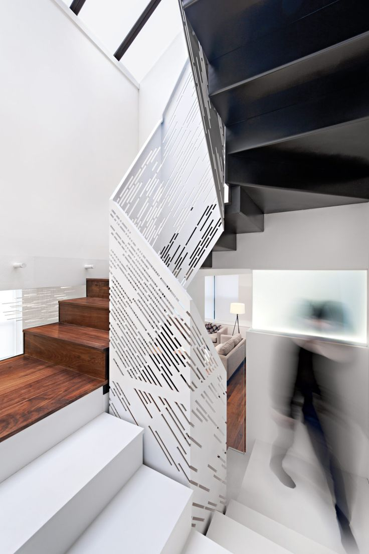 Perforated metal stair rail. Chang-Klimoski's Light-filled NYC Chelsea Loft