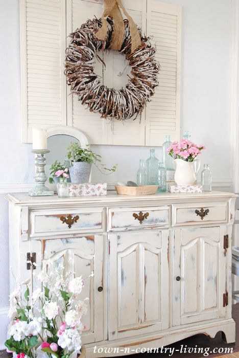 Create a Spring Vignette. shabby chic, painted furniture, distressed furniture, white furniture, buffet, spring decor, spring decorating ideas, vintage bottles