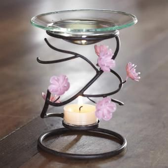 It's Cherry Blossom time! Perfect aroma melt warmer for the spring season! Great price takes a tealight and scent plus melt.  Reg.$30 Now just $18.  Perfect for MOM!