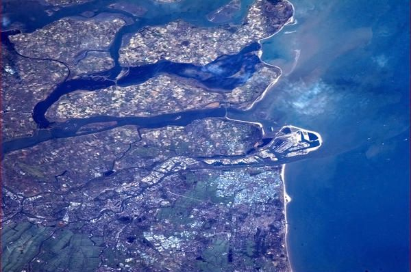 Rotterdam and the wide flat mouth of the Rhine-Maas delta.