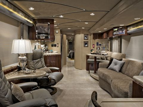 Luxury living rides with you in the Marathon motor home. Marble counters in the kitchen and bath, fiber-optic ceiling lights and leather seating throughout mean the best comforts of home are always at hand. The coach seen here is offered at $1.7 million.  Ok this is so my living room!