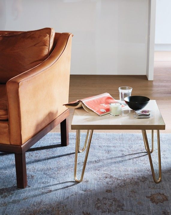 This cute little side table is totally customizable, and it only costs about $100 to make! We love the modern-chic brass legs.
