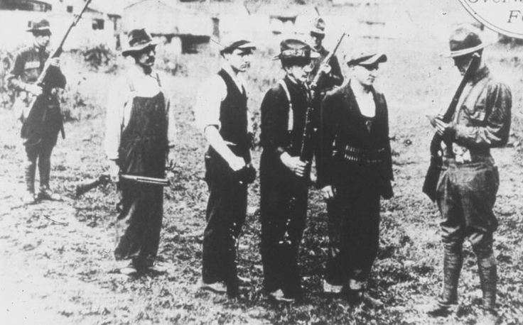 Surrendering miners turning in their guns to the US Army after the Battle of Blair Mountain, WV - 1921
