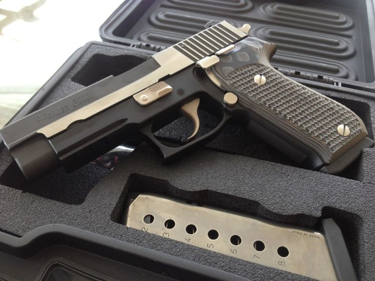 Sig Sauer P220 Equinox. It doesn't really get more stylish than this.
