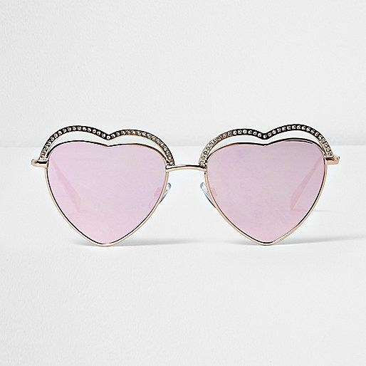 Gold tone heart shaped frames Pink lenses Filter category 3 Complies with EN ISO 12312-1:2013 / EN ISO 12311: 2013 Protects against UVA/ UVB
