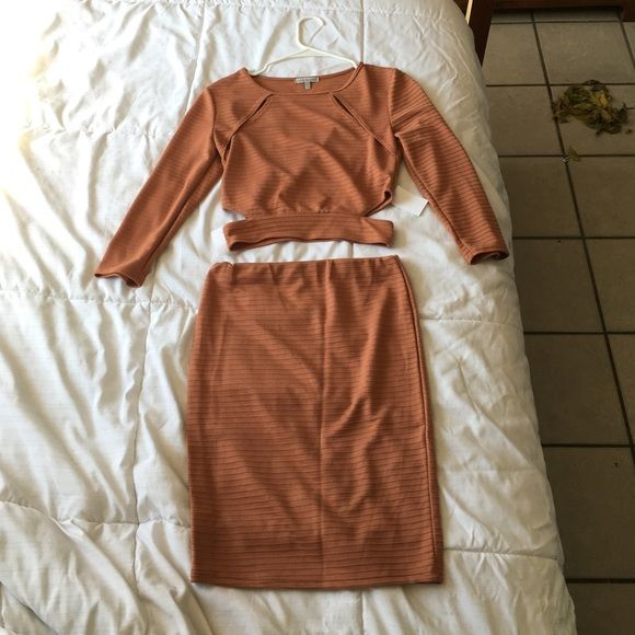 Burnt orange two piece outfit Beautiful and NWT. Skirt is small and top is medium. Never worn. Cheaper on Merc. Not trading this item. Skirts Mini