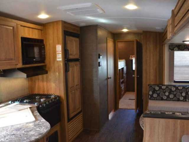 "2015 Used Keystone Laredo 303TG Travel Trailer in New York NY.Recreational Vehicle, rv, 2015 Keystone Laredo 303TG, 2015 Keystone Laredo 303TG, 36' weight is 7200/9000. Purchased new In June and under the factory warranty until June 2016. Mint condition, used only twice. Features include Front Aero fiberglass cap, 2 30# propane tanks, Life Size Package, FULL queen bed with 8"" Serta Sleeper upfront, 39"" flat screen, 3 zone speaker, am/fm/cd/dvd with Bluetooth, main living area & slides have…"