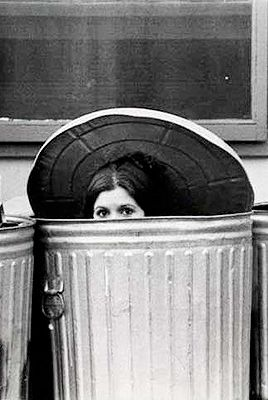 Carrie Fisher hiding in the trash cans on the backlot of the Star Wars set, 1976