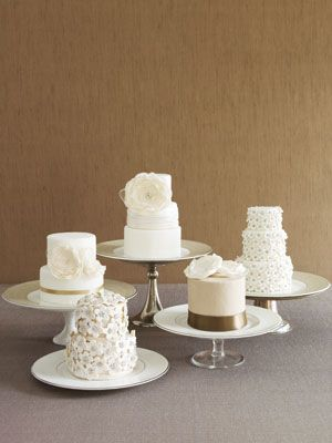 Multiple small wedding cakes or a small cake for each reception table!