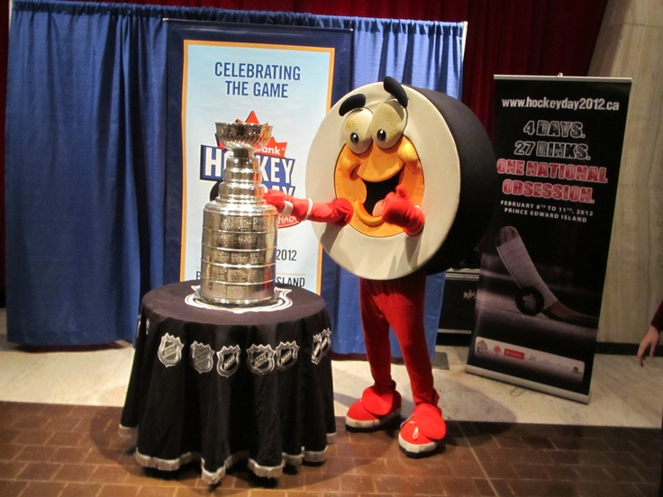 Admiring the Stanley Cup. (Peter Puck at Hockey Day in Canada)