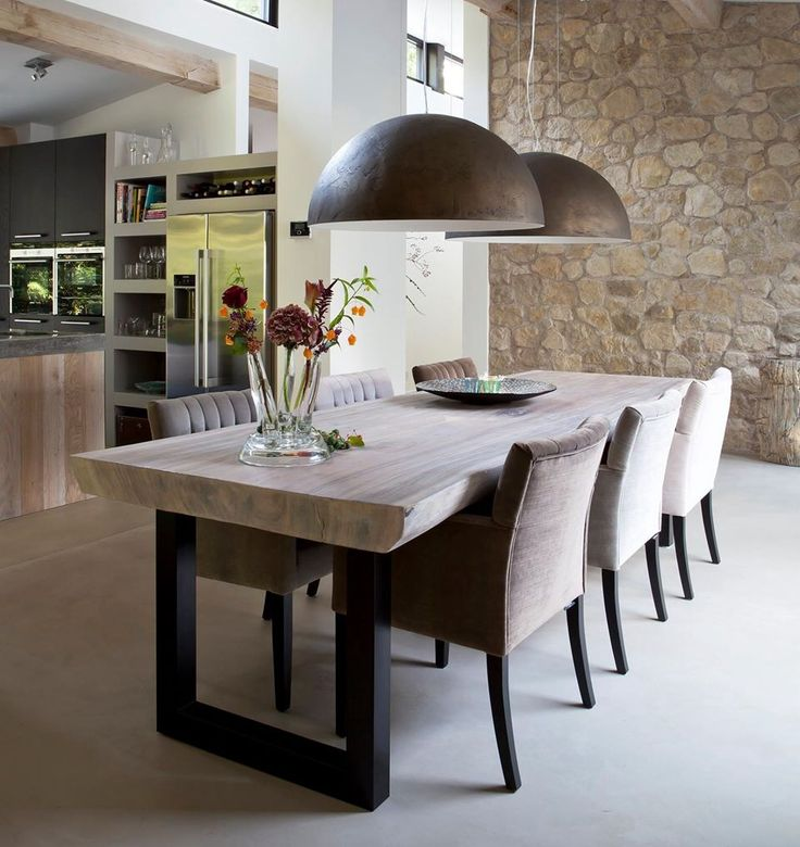 Dark and light chairs, wooden table top