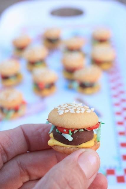 Cookie Burger Bites--nilla wafer buns, hershey's kiss burger, green coconut lettuce, royal icing mustard & ketchup.