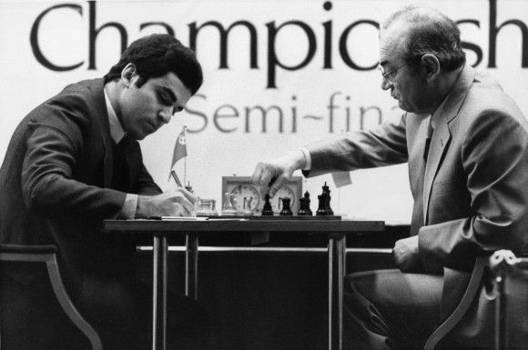 Garry Kasparov, 20, (L) the young Soviet number 2, makes notes as his opponent Russian exile Victor Korchnoi makes a move during the World Chess Championship semi-final in London on Nov. 25, 1983. (AP Photo/Taggart)