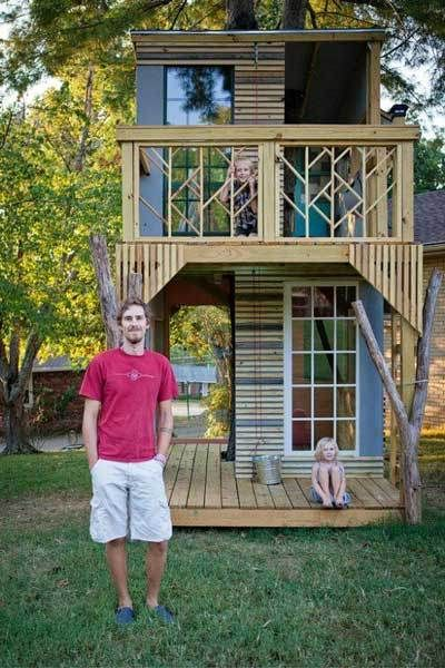 A tree runs through the center of this amazing outdoor abode that one super cool and talented dad built for his kids. In addition to a patio and balcony, the two-story stunner even boasts electricity.