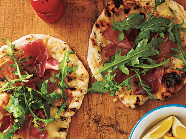 Grilled Pizza with Prosciutto, Arugula, and Lemon | Gear up for your next football game with these delicious grilled recipes. Tailgating usually means burgers and hot dogs, which definitely aren't absenthere, but we've also thrown in some mouth-watering extras like Tangy Beer-Can Chicken and Grill-Smoked Baba Ghanoush. So fire up the grill and whip together some new game day favorites.
