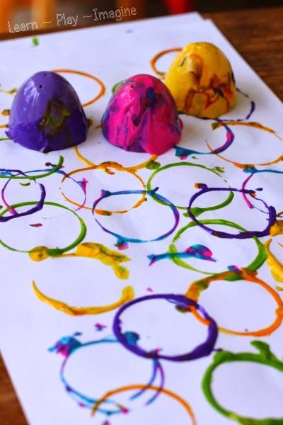 Painting with plastic Easter eggs - a fun and frugal way to explore print making. Bonus: it builds fine motor skills!
