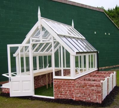 """The Frost Greenhouse (quote from their blog, """"Composting Composting is a metaphor for the natural cycle which is gardening. We supply traditional boarded fronts with side channels coloured to match your greenhouse which fit between the brick walls of each compost bay which, built alongside your greenhouse, will generate heat to keep the building warm, naturally."""" How do Brits know so much about gardening? Must use this nugget in my own greenhouse design."""