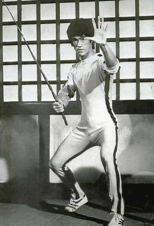 Bruce Lee. From THE GAME OF DEATH. Ironically died before finishing.