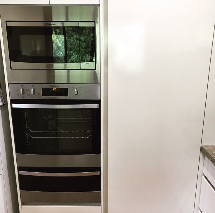 Customer Solutions - Microwave, Oven & Grill tower next to a vertical finger pull pantry. www.brisbanekitchensolutions.com.au #brisbanekitchensolutions #kitchenrenovation #brisbanekitchen #brisbanekitchendesign #kitchenrenovation