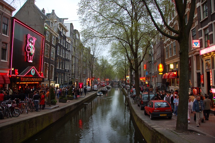 De Wallen, the largest red-light district of Amsterdam, is a major tourist attraction.