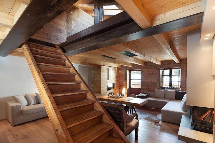 UN CALDO CHALET DI  DESIGN : Ingresso, Corridoio & Scale in stile in stile Scandinavo di archstudiodesign