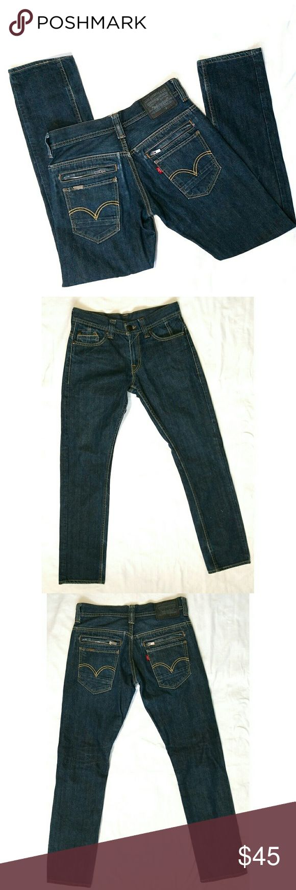 """511 Levis skinny jeans dark wash zipper pockets Mens 511 Levis skinny jeans, size 30x32, dark wash, back zipper pockets. Made in Mexico. 100% cotton. There are a few very tiny discoloration marks on the leg. See last photo for reference. Price reflects the flaw.  Waist: 15"""" Rise: 12"""" Inseam: 32"""" Length: 41"""" Levi's Jeans Skinny"""
