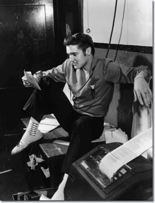 This photo shows Elvis at The Commercial Appeal in Memphis, TN on the night of June 8, 1956. It was taken by Memphis photographer Barney Sellers who worked for this newspaper.  Elvis dropped by The Commercial Appeal and found an offbeat note. He saw a story that a Canadian radio station was banning his records. 'A lot of people like it', was one of his comments.