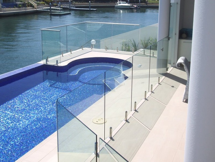 Semi frameless swimming pool glass fencing is affordable and secure method to protect kids jumping into swimming pool by mistake.