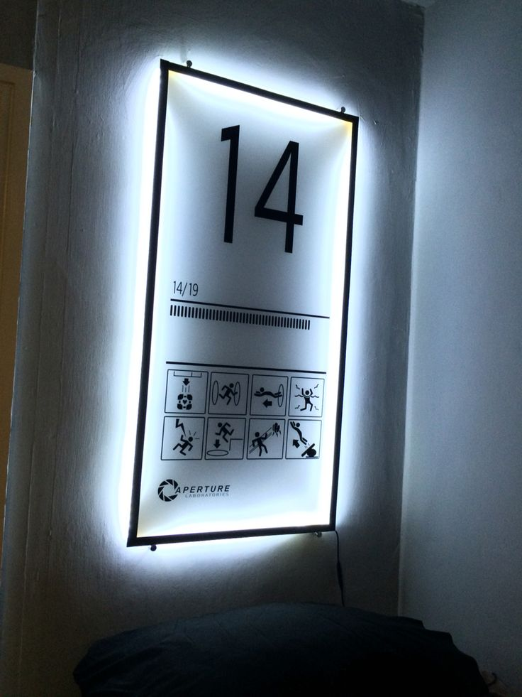 Portal2 wall art. Frosted acrylic sheet, vinyl print and LED light strip.