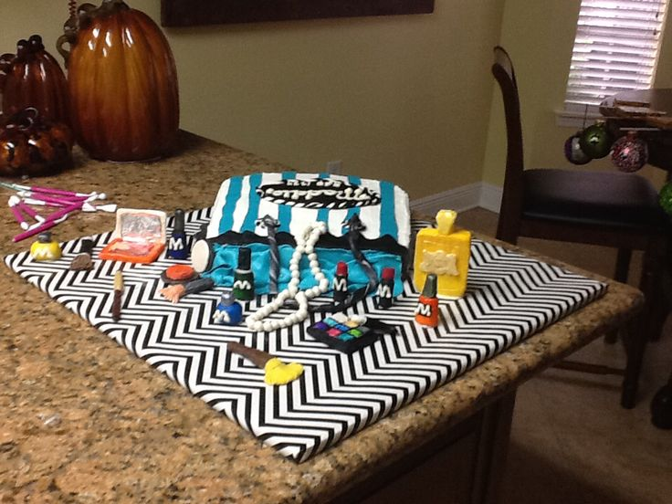 Made this for my granddaughters 15 th birthday! Shopping bag with all the goodies! Cake is wedding cake with buttercream icing! Fondant trim and tissue! Modeling chocolate for the makeup which I carved and  painted with food coloring! She loved it!