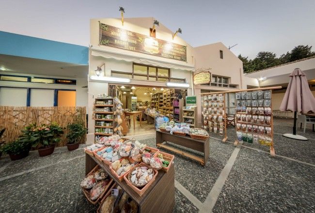 Welcome to our traditional Shop, located at Tsilivi in Zakynthos!  In our store you can find and taste traditional, handcrafted products not only from Zakynthos, but also from all over Greece.  An amazing variety of products produced and manufactured by our family, like olive oil, olives, raisins, wine, raki, oil cheese and liqueurs.  You will also find a wide variety of spices and herbs, pasta, sauces, various foods and drinks with special flavors and handmade gifts made just for our store.
