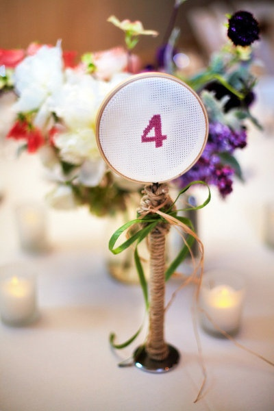 Cross stitched table numbers. Awesome. Photography by kantzos.com