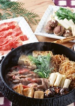 Sukiyaki is a type of dish prepared by simmering beef and vegetables in Warishita (a blend of sugar, soy sauce, Japanese sake, and Mirin[type of rice wine]). It is one of the popular hot pot dishes in Japan.