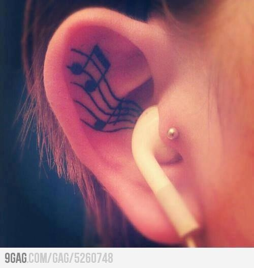 Music to my ears. Now this is a cool tat