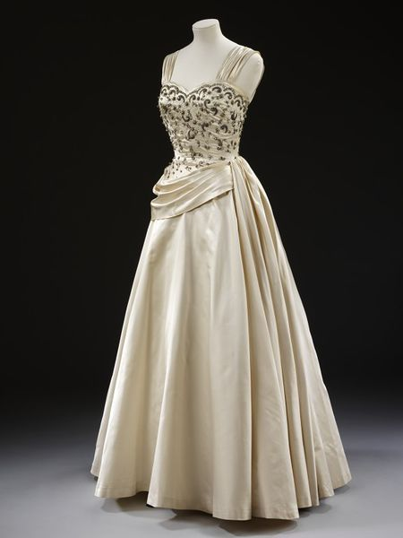 Evening dress  Place of origin: London, England (made)  Date: late 1950s (made)  Artist/Maker: Victor Stiebel, born 1907 - died 1976 (designer)  Materials and Techniques: Embroidered silk satin with beads and rhinestones, boned and padded, tulle, metal